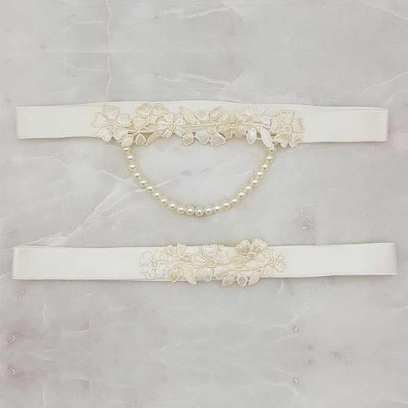 Ivory lace and pearl garter set