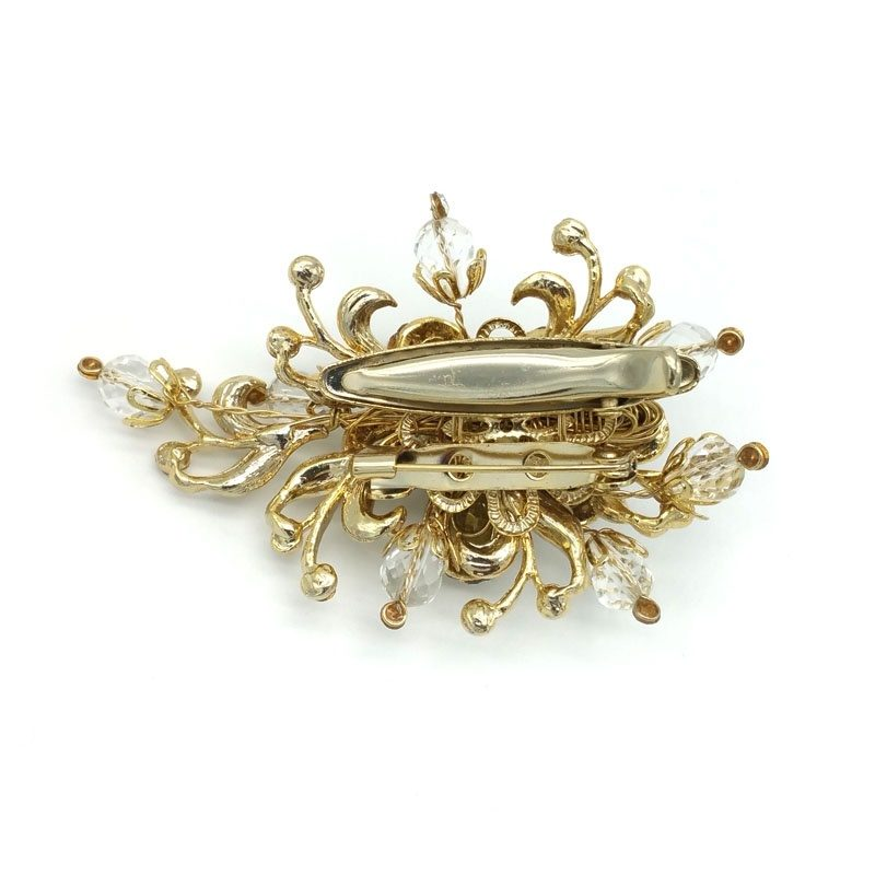 gold crystal brooch and hair piece