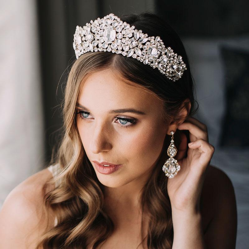gold bridal crown and statement earrings