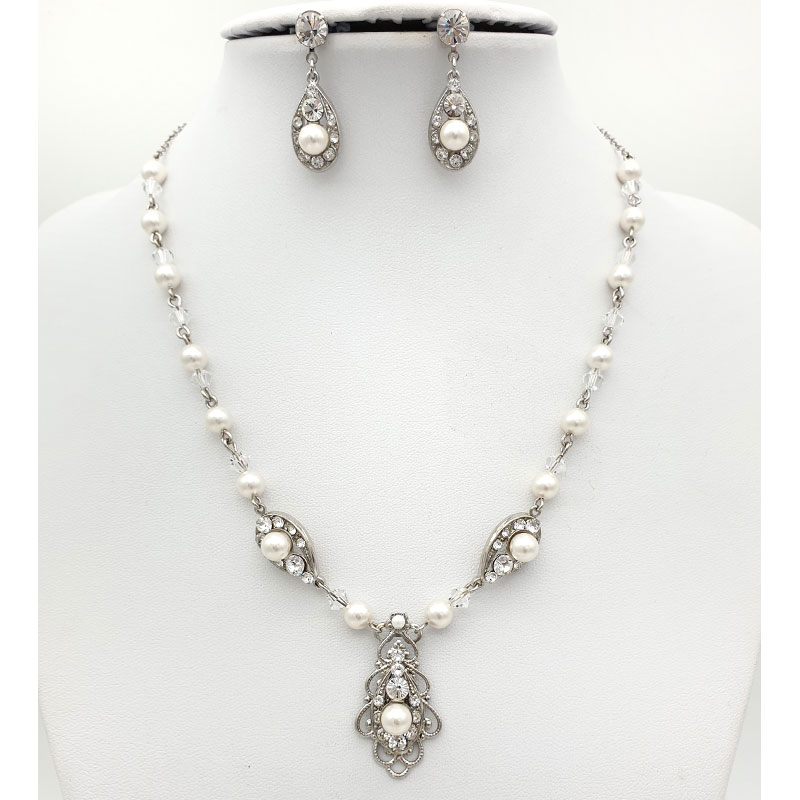 Pearl and crystal necklace earrings set