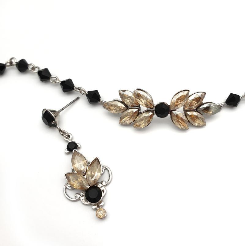 Black and beige crystal earrings and bracelet set