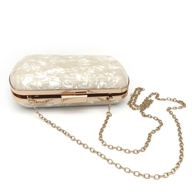 Ivory pearl acrylic clutch